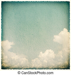 Clouds on a textured, vintage paper background