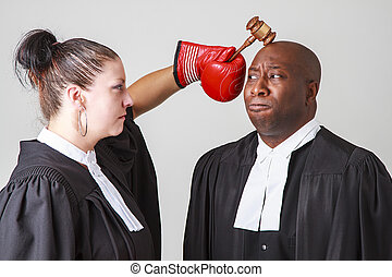 Head bashing - woman hammering a man on the head with a...
