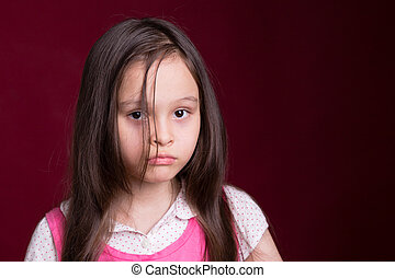 Young Asian American girl on red background - Young Asian...