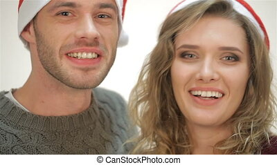 Cute couple says Happy New Year. Young attractive couple in...