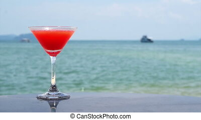 red cocktail on the summer sea - Video of red cocktail on...