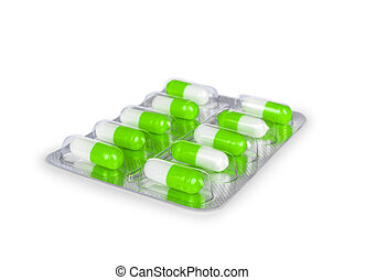 green capsules in the package isolated on a white background
