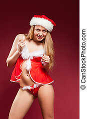 Beautiful sexy girl wearing santa claus clothes, over red...