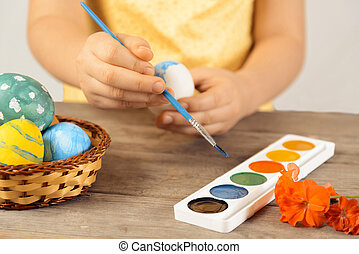 Girl paints egg for Easter day - Unrecognizable girl paints...