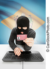 Hacker with USA states flag on background and ID card in...