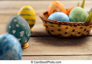Colored eggs on Easter day on a wooden table
