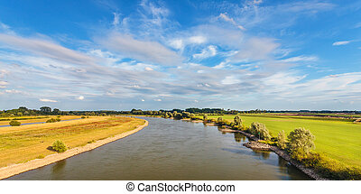 The old Dutch river IJssel in the province of Gelderland -...