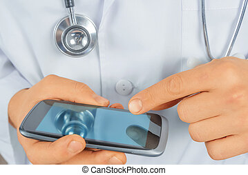 Man doctor with mobile phone