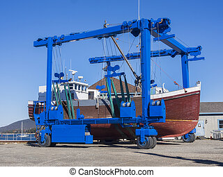 Boat rolling to drydock - Fishing boat being rolled into...