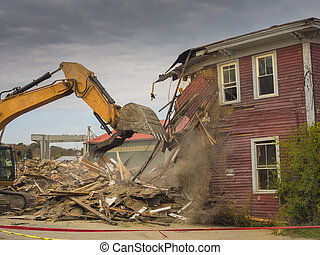 House demolition - A digger demolishing a house for...