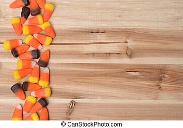 Candy Corn - candy corn on wooden table background