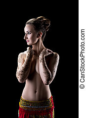 Sensual topless woman with henna pattern on hands