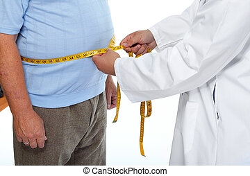 Doctor measuring obese man stomach. - Doctor measuring obese...