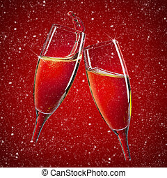 Two champagne glasses over red christmas background with...