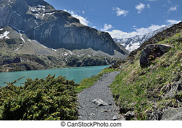 Hiking trail along the moutain lake - The pathway is along...