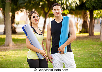 Pretty couple doing some yoga - Portrait of an attractive...