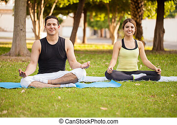 Latin couple doing some yoga - Attractive Latin young couple...