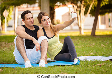 Sporty couple taking a selfie - Attractive young Latin...