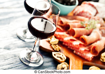 Wine party - Red wine with charcuterie assortment on the...