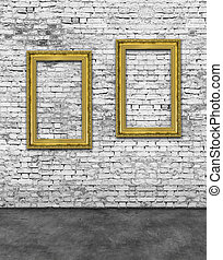Two vertical golden frames on brick wall - Two vertical...