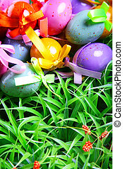 Easter Background - Colorful Easter eggs on the grass