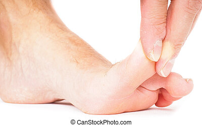 Male person pulling big toe backwards isolated towards white