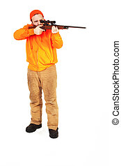Riffle Ready - a man with a riffle positioned to shoot...