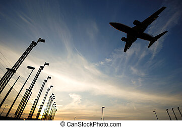 Landing plane and sunset - Plane is going to land in an...
