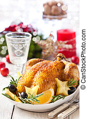 Christmas place setting. - Whole roasted orange chicken with...