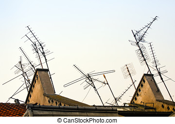 TV antennas on roof - Multiple home TV antennas mounted on a...