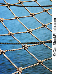 Safety net - View through the safety net at the blue sea...