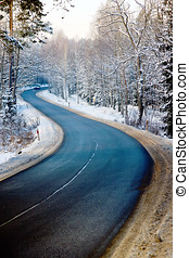 Forest road in winter - Winding Road in Masuria, forest in...