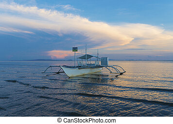 outrigger boat in philippines - traditional bangka boat on a...