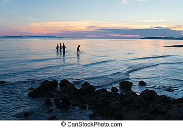 children searching for seafood - DONSOL, PHILIPPINES - MAY...