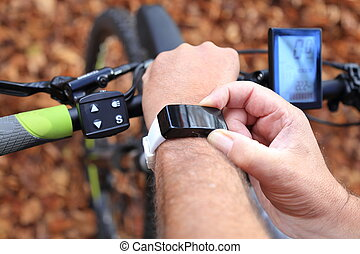 Smartwatch and E-Mountainbike - A Smartwatch and a...