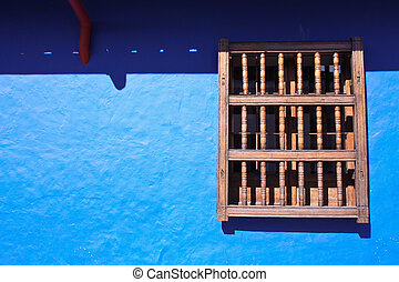 Detail of a colonial house window and wall in blue - Window...