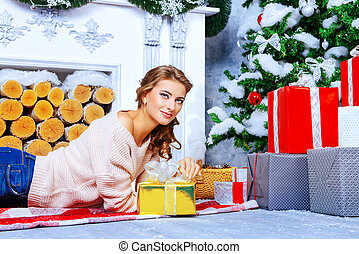 fireplace happines - Charming young woman celebrating...