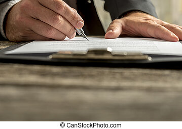 Closeup of businessman signing contract, document or legal...