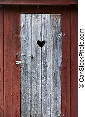 Door on outdoor toilet - Door with heart on old wooden...