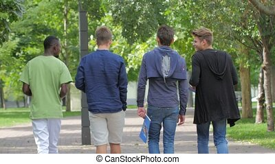 Students of college walking together on campus - Full length...