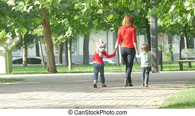 Family on a Walk in Summer. Child with mother Together -...