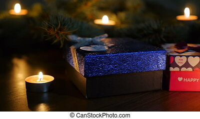 Christmas candles. Christmas and New Year decoration with a lit candle and beautiful colorful ornaments with blurred background,video clip