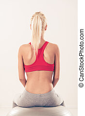 Fitness Woman - Cute sporty Young girl sitting to pilates...