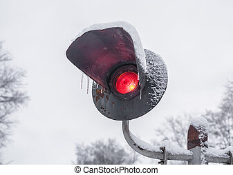 red railroad caboose marker lamp under the fresh snow