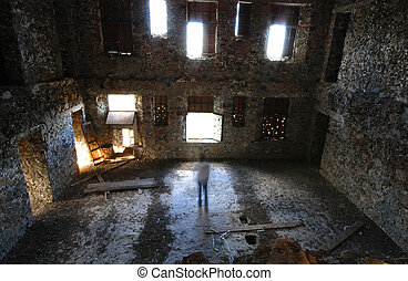 Scary room with many windows and a man acting as a ghost