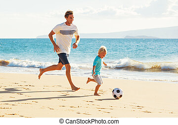 Father and Son Playing Soccer - Happy Father and Son Having...