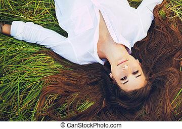 Woman Relaxing Outdoors - Beautiful Young Woman Relaxing...