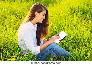 Happy Young Woman Using Tablet