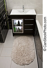 Bathroom carpet and cabinet with toiletries in modern...