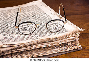 Old Germanic book - Glasses lying on an old-Germanic...